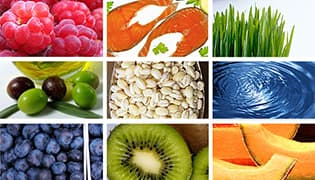 various fruits such as kiwi, melon, blueberries, grapes next to water, wheat grass, nuts,