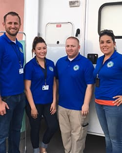 Public Health EMS Agency staff, listed from left to right, James Pintus, Karrah Caldwell, Christopher Herring and Mayra Ibarra all wearing blue Public Health t-shirts