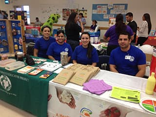 Public health employees at a health event, Mayra Ibarra, Maria Castillo, Laura Apodaca, Jorge Torres